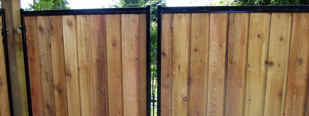 Wood gates on steel frames tower fence products
